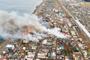 Smoke rises from houses and buildings during a fire, near JR Itoigawa Station, in Itoigawa, Niigata Prefecture, Japan, in this photo taken by Kyodo December 22, 2016. Mandatory credit Kyodo/via REUTERS ATTENTION EDITORS - THIS IMAGE WAS PROVIDED BY A THIRD PARTY. EDITORIAL USE ONLY. MANDATORY CREDIT. JAPAN OUT. NO COMMERCIAL OR EDITORIAL SALES IN JAPAN.